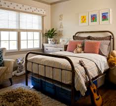 wrought iron bed kids traditional with brown pillows striped