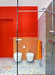 glass mosaic tile trends in your bathroom renomania add a pop of colour glam up your tiled shower with half tiled mosaic wall in a lighter version of the colour used in the background