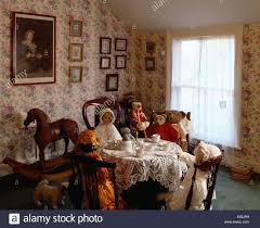 doll u0027s teaparty in victorian dining room with floral wallpaper
