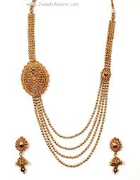 gold haram sets golden necklace set with white stones and gold finish