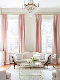 tall soft pink curtains in this parlor greek key layered rugs and sumptuous pink curtains in this elegant room by shophouse design