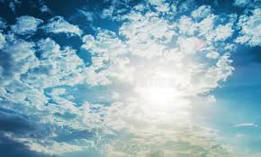 shining sun with lens flare blue sky with clouds background stock