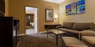 Living Room With Sofa Jacuzzi Suite 2 Queens U0026 Sofa Sleeper Best Western Royal Sun