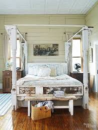 bed frame made from salvaged vintage porch posts salvaged wood
