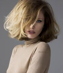 70s bob hairstyle with teasing volume and a turtleneck