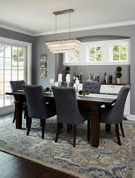 Dining Room With Dark Wood Floors Beautiful Patterned Rug And - Dining room rug ideas