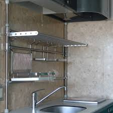 unusual kitchen design ith stainless steel kitchen pipe shelving