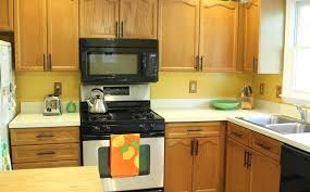 what hardware looks best on oak cabinets oak cabinets family style living
