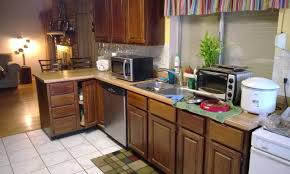 granite countertop light wood cabinets in kitchen miele island
