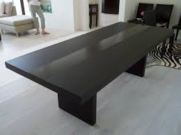 Black Wood Dining Table Black Wooden Table With Two Legs Placed On The Gray Flooring
