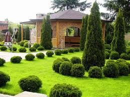 neat and clean small yard landscaping design in a slope area best