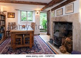 dining table in front of fireplace period small cottage dining room with tile floor oak furniture and