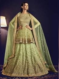 color heavy embroidered wedding guest lehenga by nakkashi