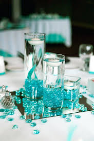 peacock centerpieces turquoise vases for wedding vintage peacock themed
