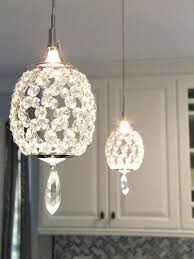 pendant lighting for kitchens crystal pendant lights over a peninsula bring a touch of glam to