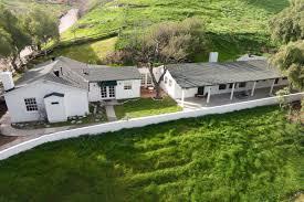 pair of midcentury ranch homes on 2 6 acres of rolling hills seeks