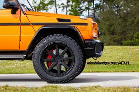 lifted smart car orange is the new black dual lifted g wagons by wheels boutique