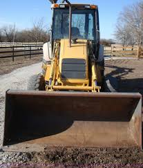 1999 new holland 555e backhoe item a1821 sold february
