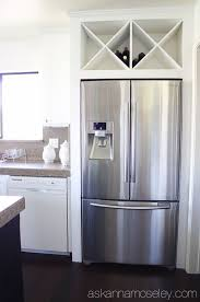 space between top of refrigerator and cabinet custom wine rack above fridge instead of a useless cabinet ask