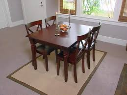 inspiration of rugs for dining room table and placing rugs under