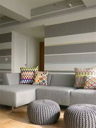 diy striped wall in a living room via colortheory