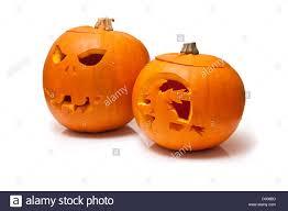 halloween carved pumpkin lantern u0027s isolated on a white studio