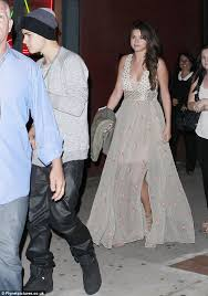 selena gomez shines as she dresses up in maxi dress while justin