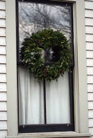 creative home expressions wreaths in windows are you an inny or