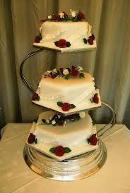 3 tier wedding cake stand and 3 tier hexagonal wedding cake on an s shaped cake stand