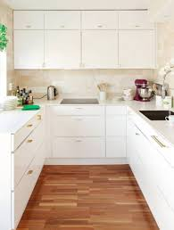 White Kitchen Cabinets Design by Modern Kitchen Cabinets And Gold Brass Modern Drawer Pulls In
