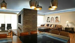 midcentury modern apartment interior with brick room divider with