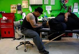 tattoo businesses thrive despite recession as more americans