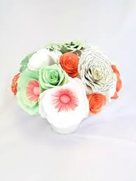 floral centerpiece filled with handcrafted coral and mint green
