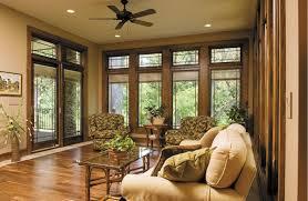 living room simple brown single chair oak floors glass sliding