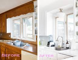 removing the scalloped wood valance over the kitchen sink in my