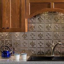 fasade backsplash fleur de lis in brushed nickel