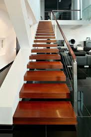 architecture floating red wood stairs with wood handrail with
