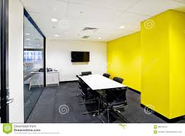small meeting room with yellow walls and tv stock photo image