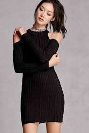 a ribbed knit bodycon dress featuring an open shoulder design