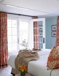 orange bedroom curtains orange and blue bedroom love and those french doors swoon