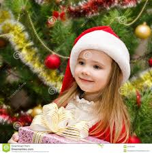 Cute Little Girl In Santa Hat With Present Stock Photo  Image of