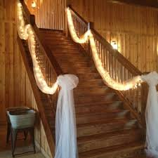 tulle and lights for the stairs over doors decorating with