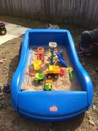 kids sand box took old toddler car bed and removed wood panel and