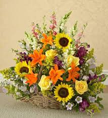 basket arrangements harvest basket a large basket arrangement containing sunflowers