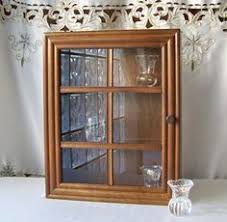 wall display cabinet with glass doors wall display cabinet w 4 adjustable shelves mirrored back cherry