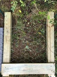 how to build a simple backyard compost bin out of wood and chicken