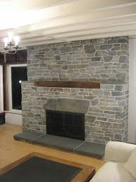grey stone fireplace with dark brown mantel shelf and rectangle