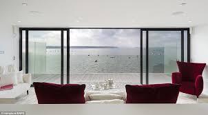 floor to ceiling glass doors sandbanks home the vanquish is on the market for 7 5million