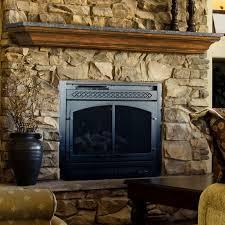 stone fireplace surround noble wooden shelf at neutral stone