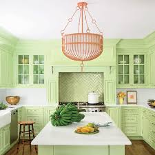 White Corian Light Green Kitchen Cabinets With Coral Pink Chandelier Cottage